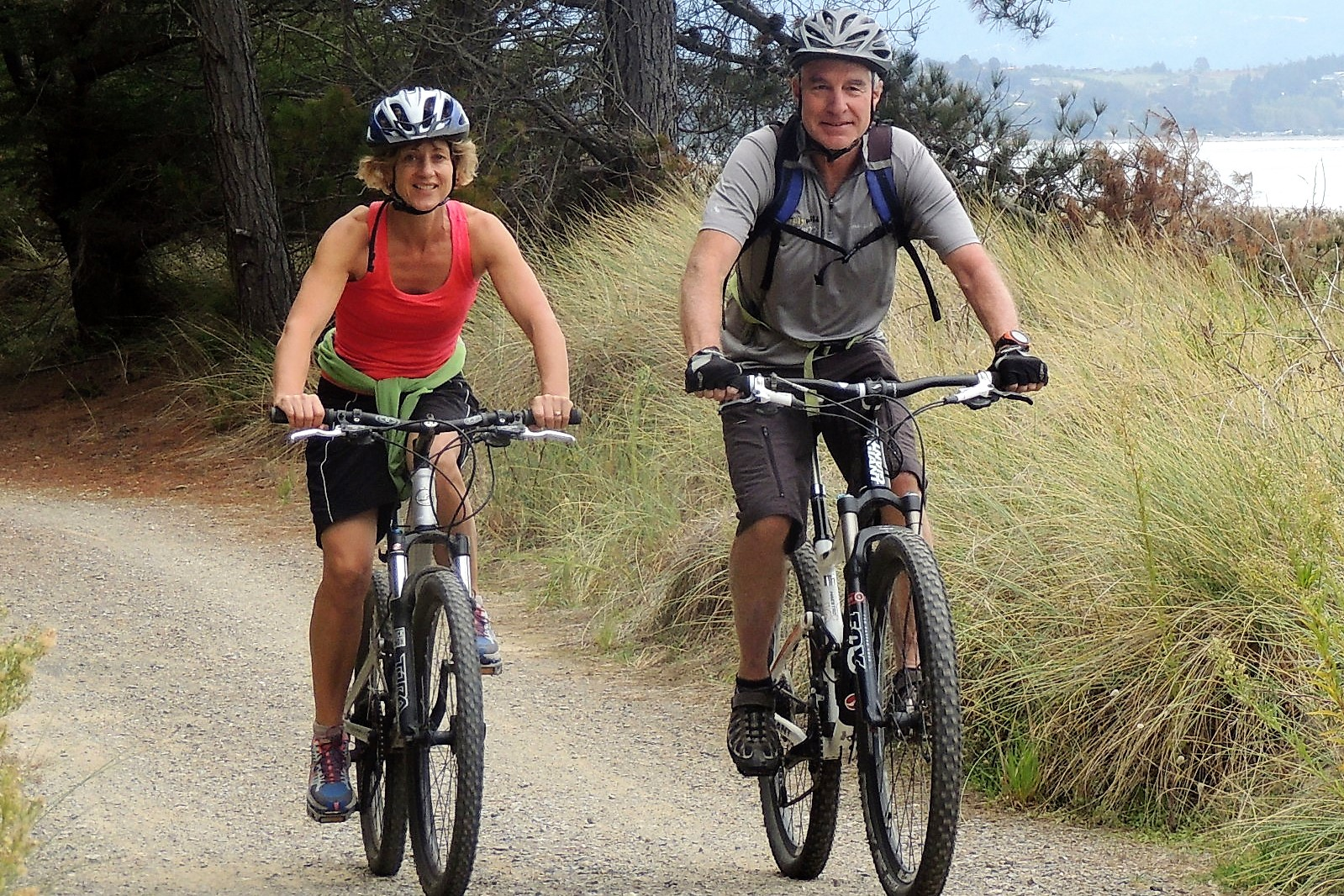 Couple cycling on The Great Taste Trail, Nelson, NZ.